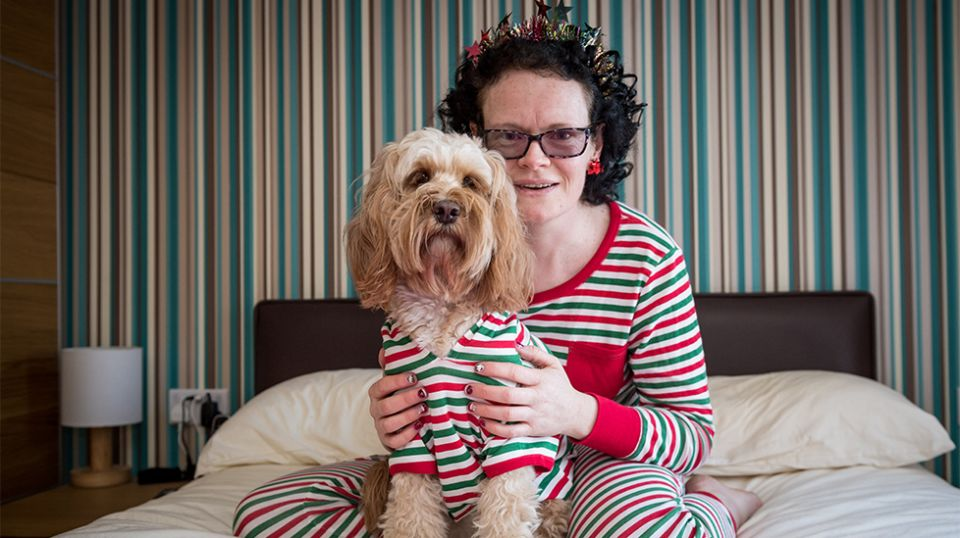 Helena Mueller and her pooch, Cockapoo, Lola. Source: SWNS / Mega